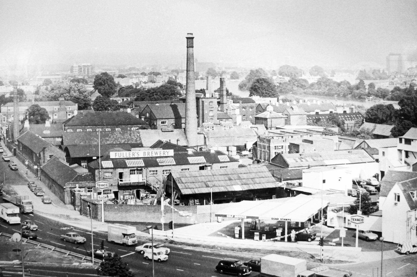 Fuller's brewery, Chiswick in the late 1960s, with the brick chimney still in place. The land for the petrol station on the corner was sold by Fuller's to the fuel company, and later had to be bought back a considerable expense as the brewery expanded