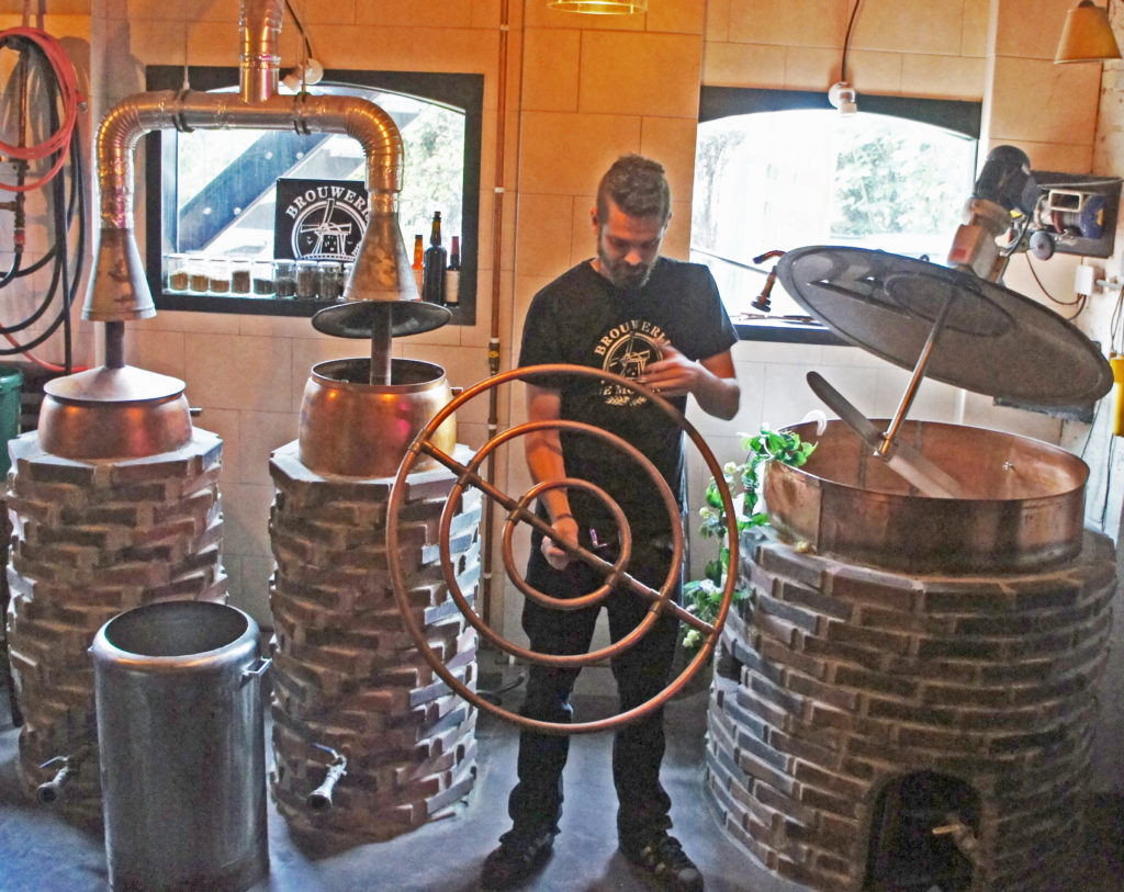 Colin Hoeffnagel with the original equipment at the De Molen brewery, two tiny coppers and a combined mash tun/fermenting vessel